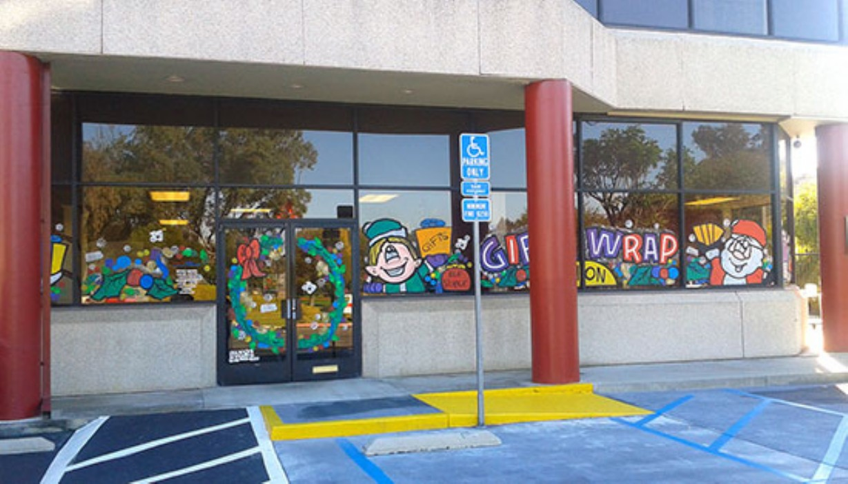 Rental office doors and windows decorated for holidays