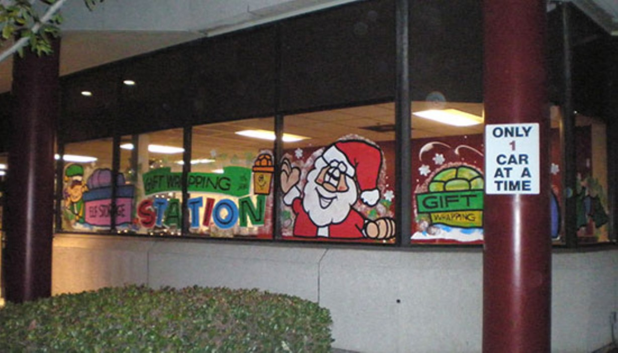Rental office holiday themed painted windows for gift wrapping station