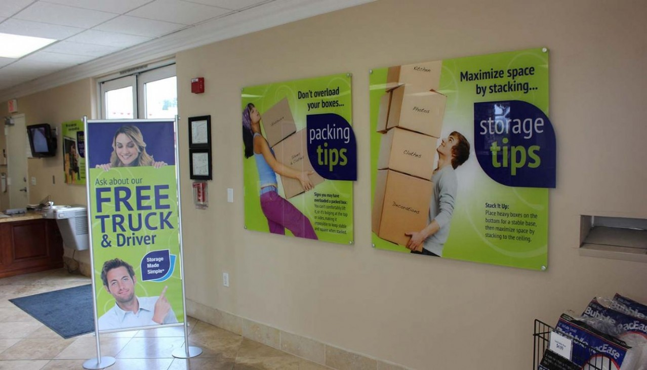 Rental office promotional signs for tips and Free Truck & Driver