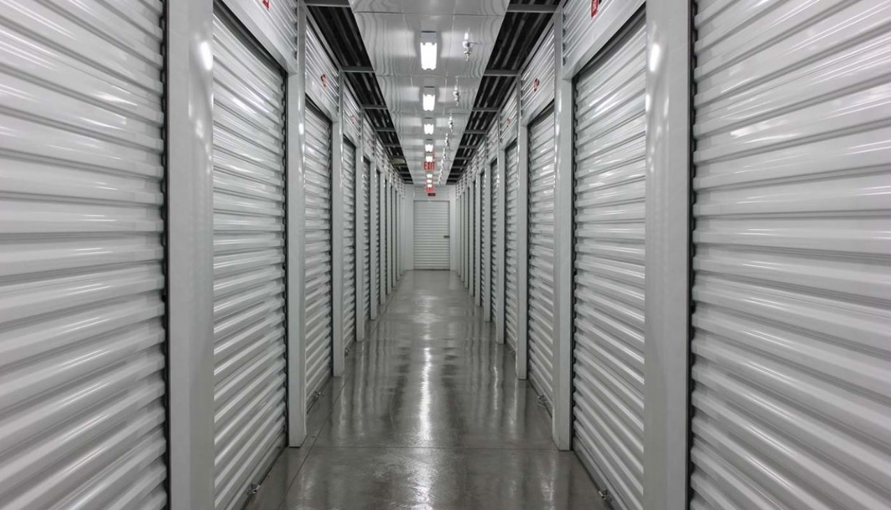 Interior hallway with a variety of storage unit sizes with roll up doors
