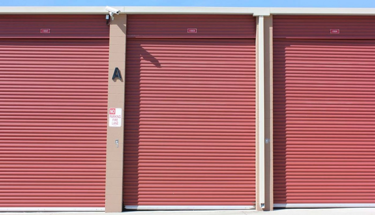 Front view row of extra large storage units with rollup doors