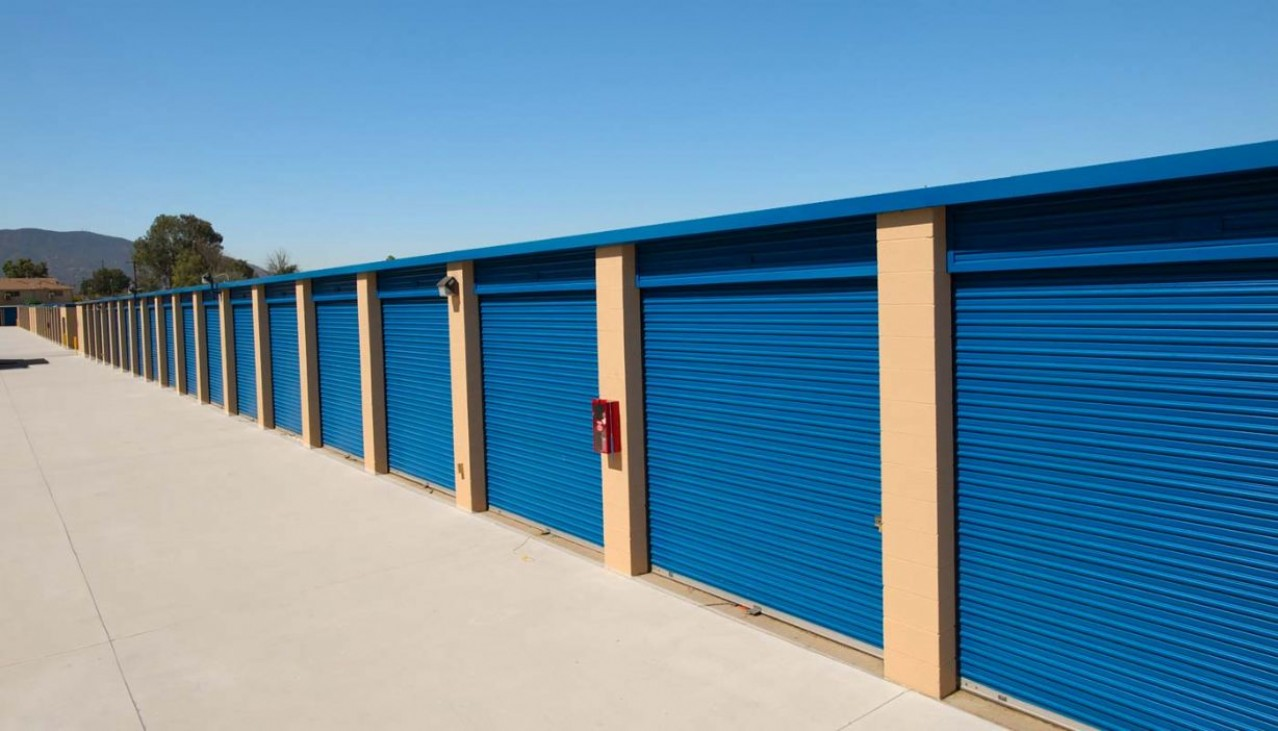 Drive up storage units with blue metal roll up doors
