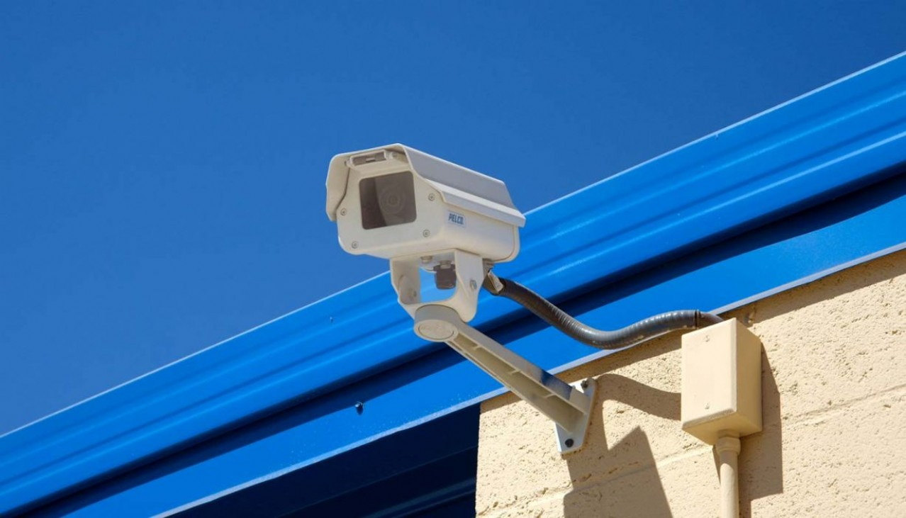 Security camera mounted on side of building