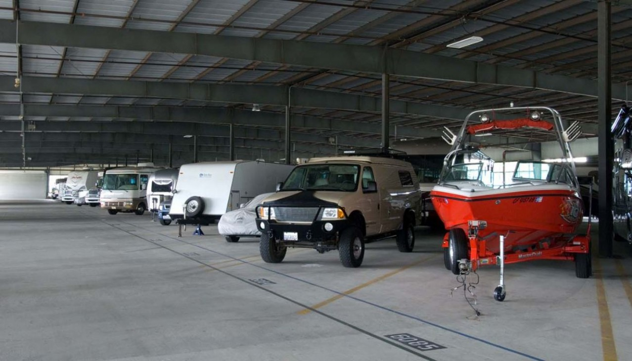 RV's and boats parked indoor storage facility