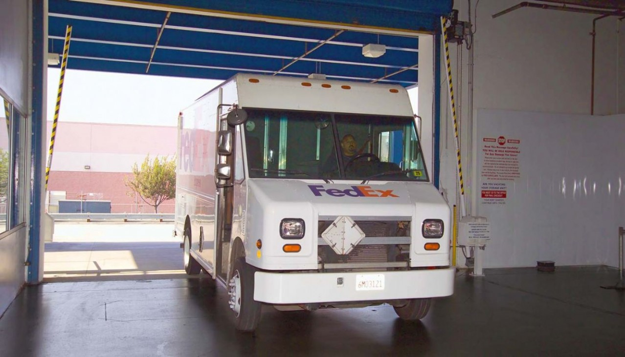 Price Self Storage West Los Angeles La Brea Avenue delivery truck driving through the front entrance to the indoor storage facility