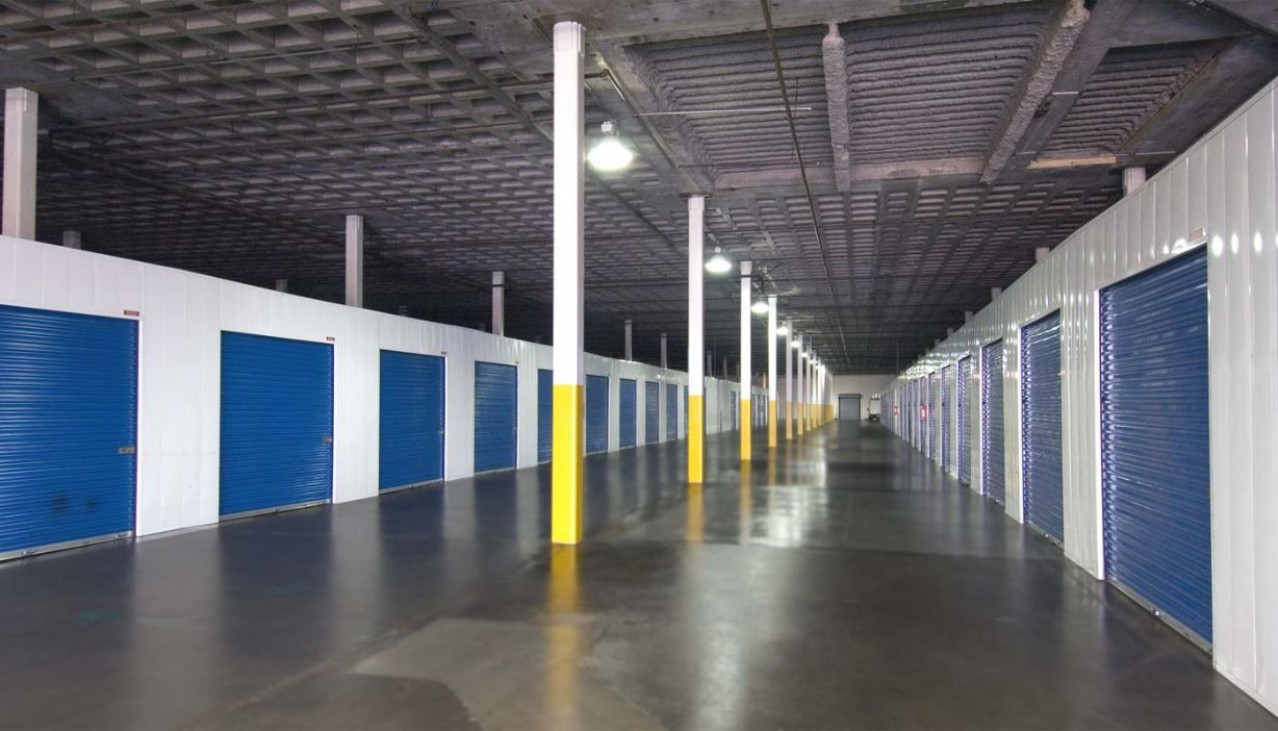 Price Self Storage West Los Angeles La Brea Avenue ground floor storage units with metal roll up doors inside a large indoor storage facility