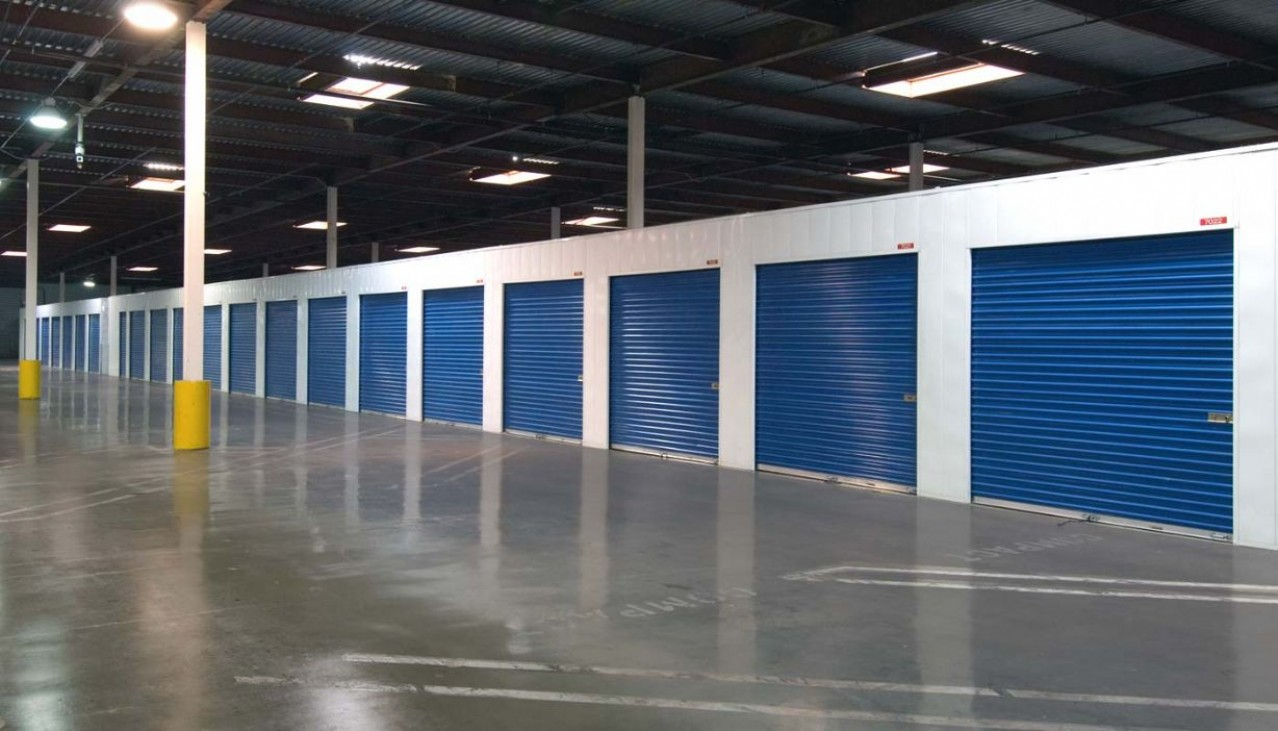 Price Self Storage West Los Angeles La Brea Avenue garage sized drive up storage units with metal roll up doors within an indoor drive in facility