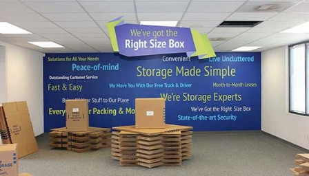 Moving box display with blue wall and graphics background