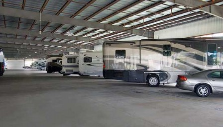 Indoor parking storage facility with motorhomes and other vehicles parked inside