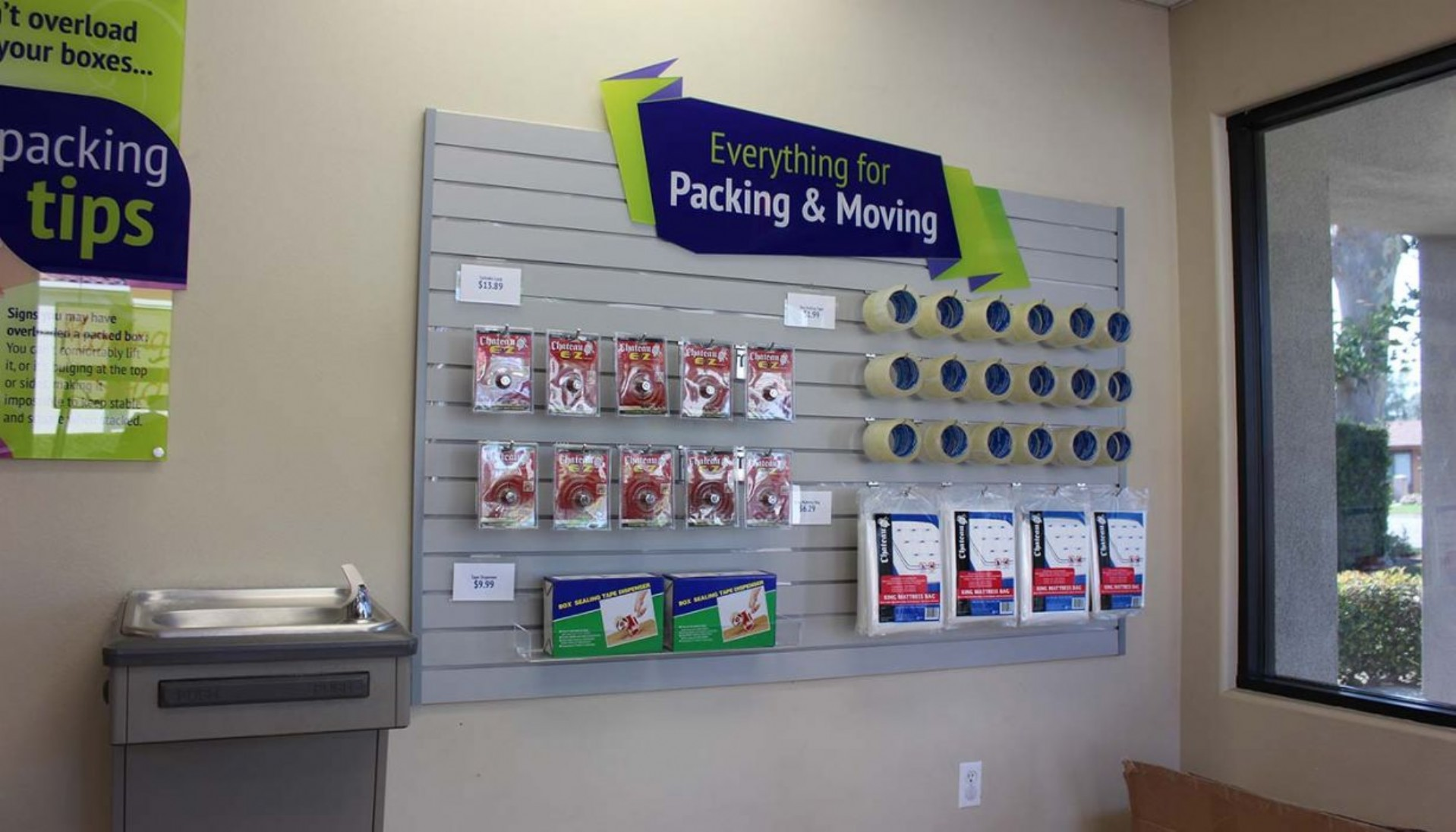 Rental office merchandise display wall with tape, bubble wrap, mattress bags for sale