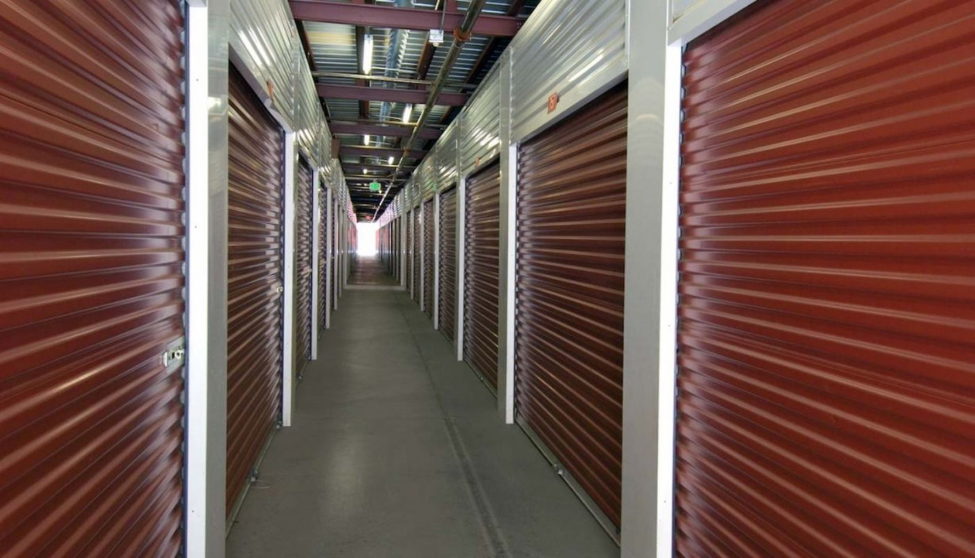 Hallway to ground floor accessible storage units with roll up doors