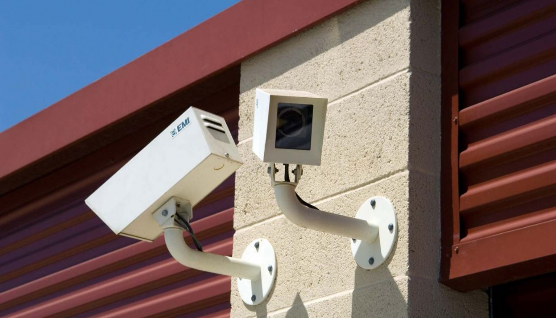 Security camera mounted on building