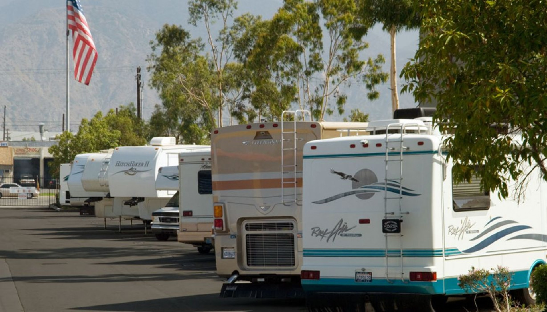 RV's parked in spacious outdoor parking storage area