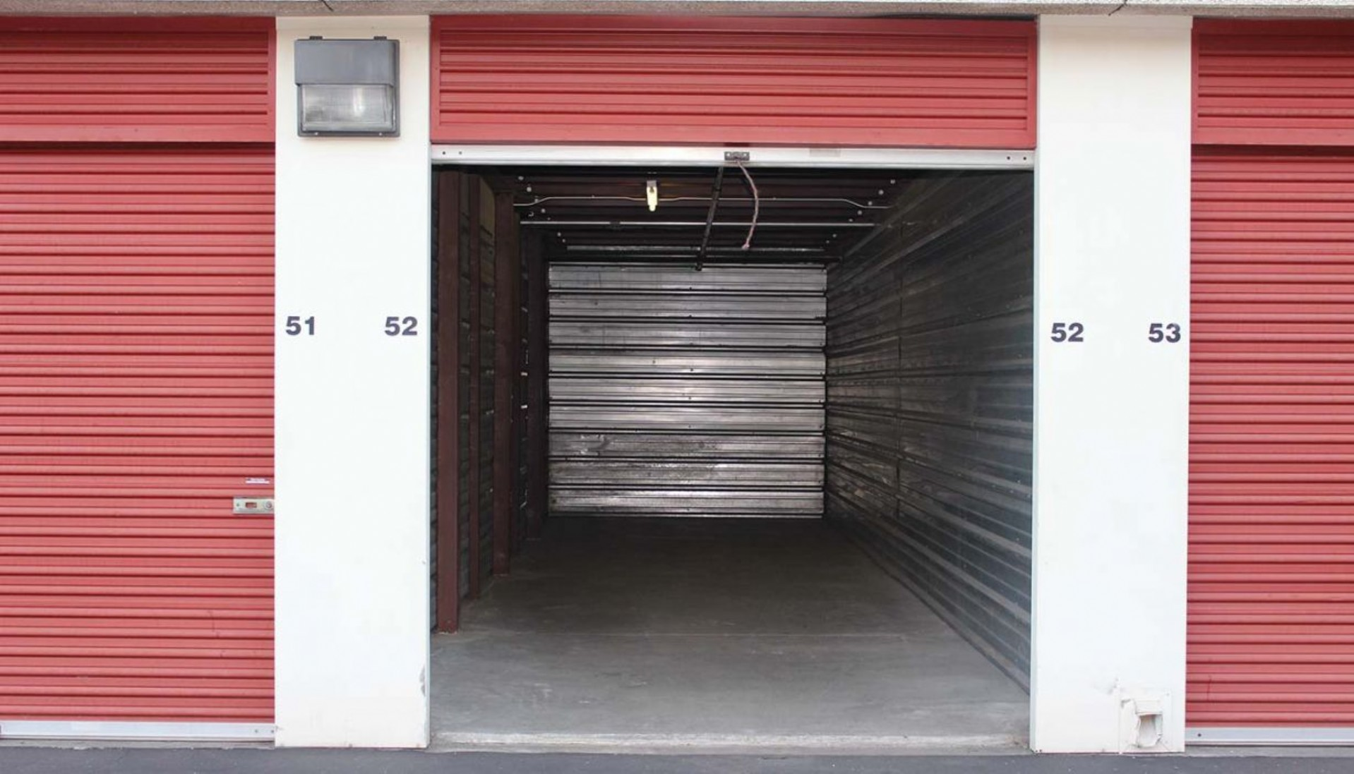 Garage sized drive up storage unit with metal walls and roll up door