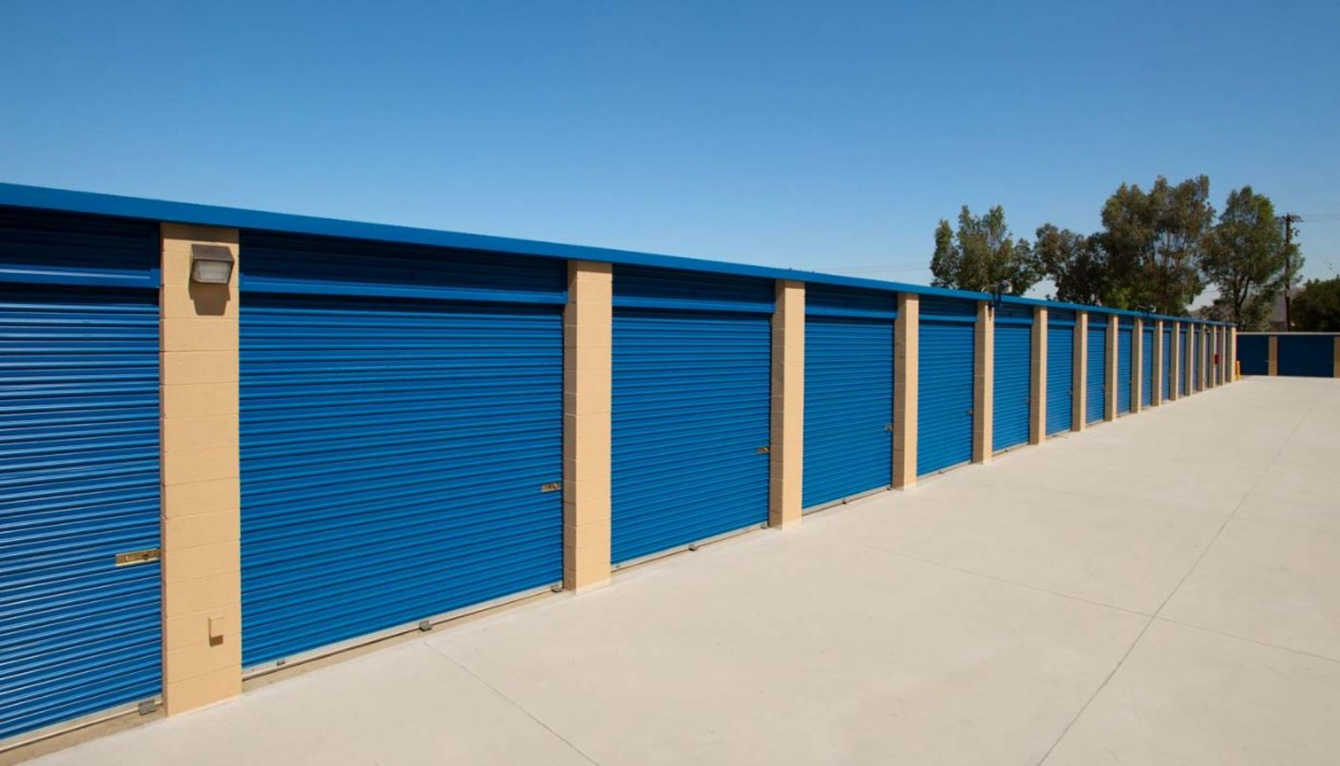 Garage sized drive up storage units with metal roll up doors