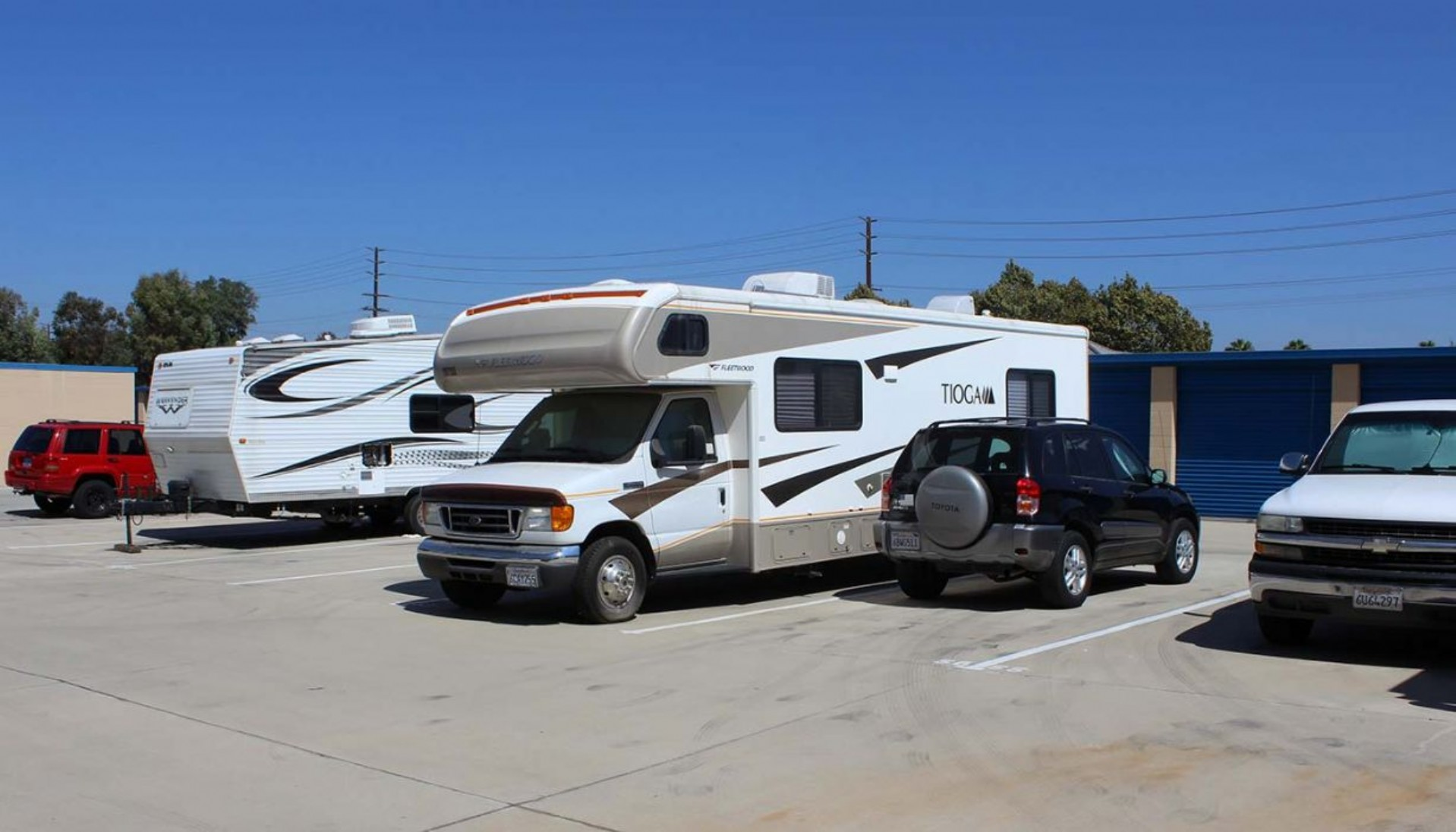 RV and SUV parked in vehicle storage parking spaces