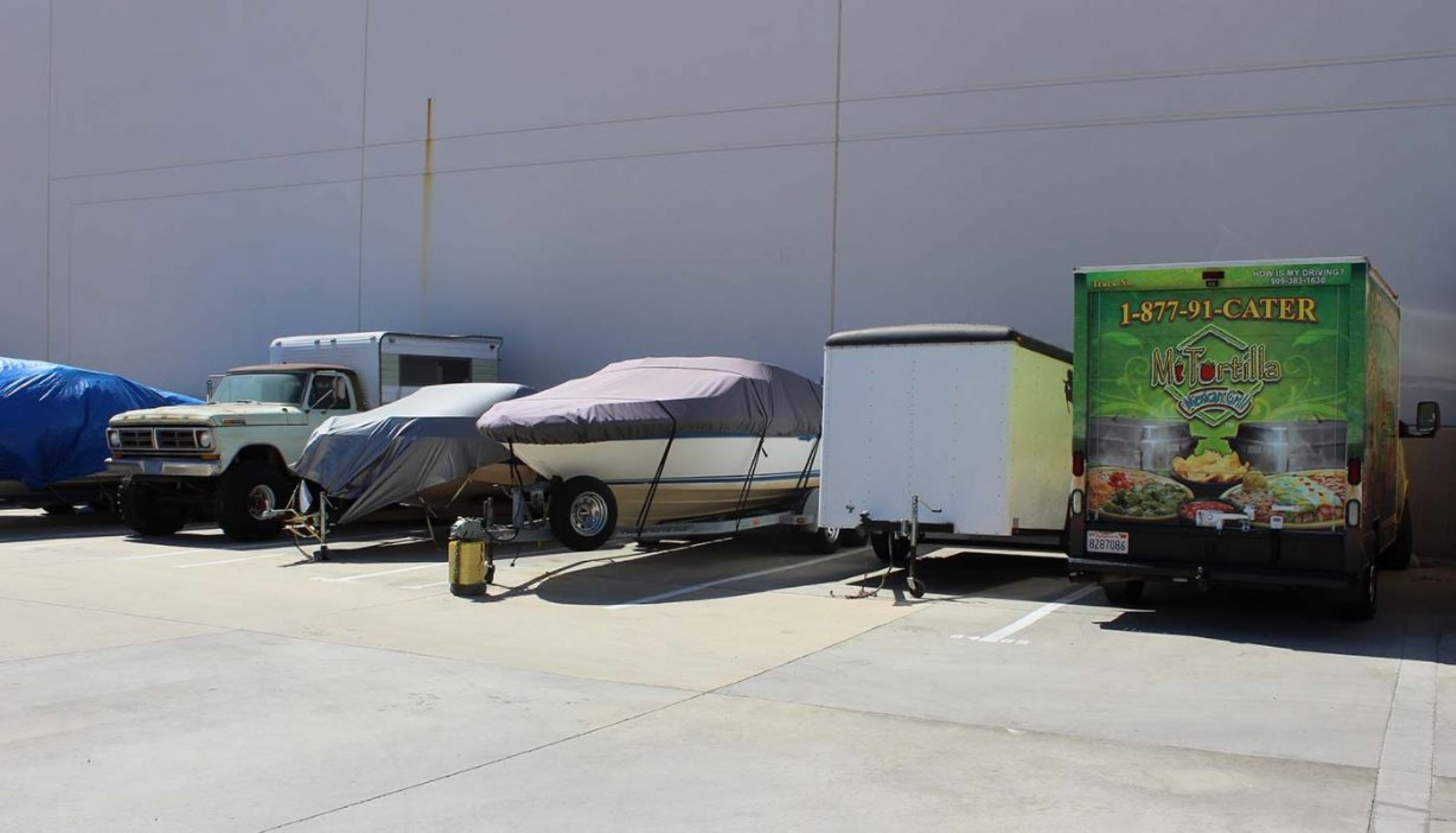Trucks and trailers parked in vehicle storage spaces