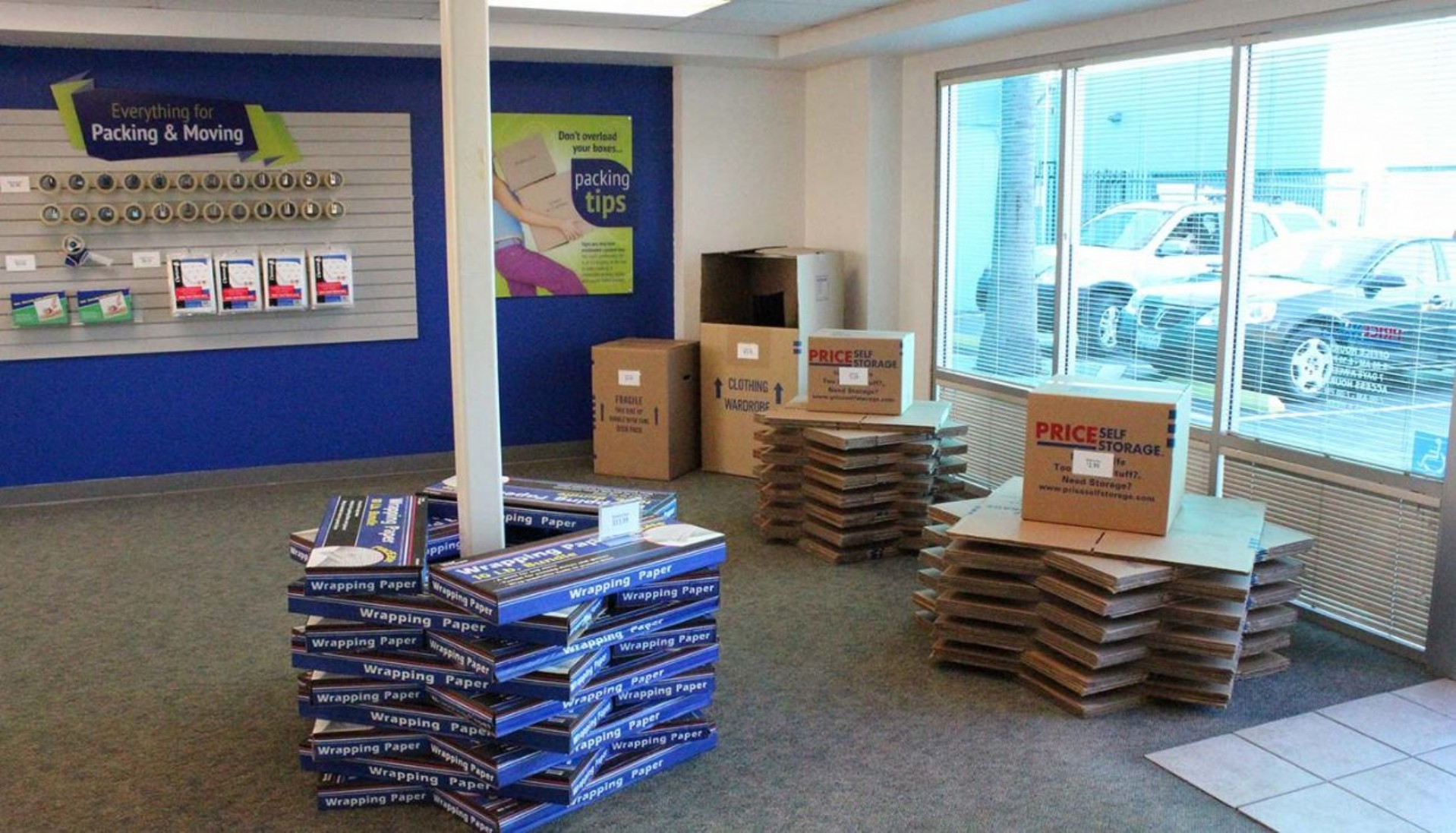 Price Self Storage Pacific Beach rental office with wrapping paper and moving box displays stacked