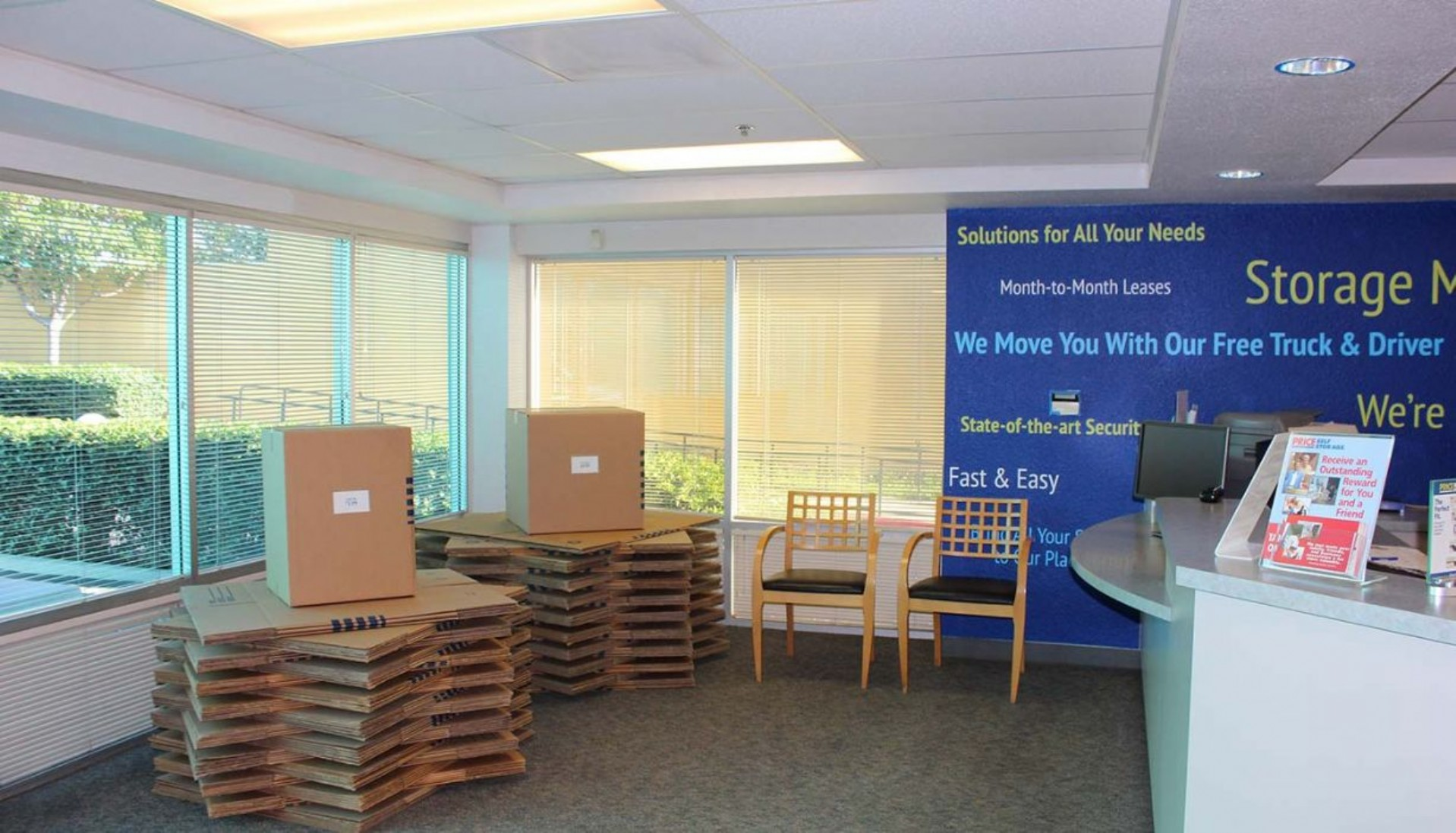 Price Self Storage Pacific Beach rental office with stacked moving boxes for sale on display