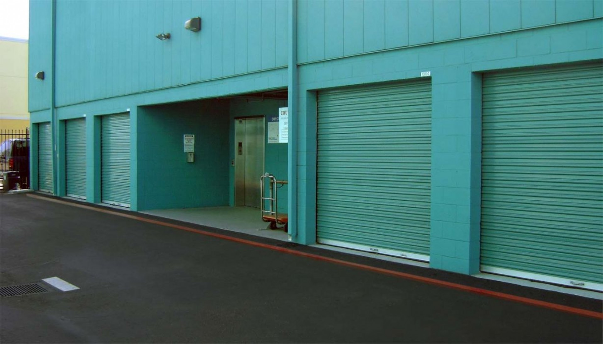 Price Self Storage Pacific Beach drive up units with roll up doors and an easy access elevator to upper levels of the building