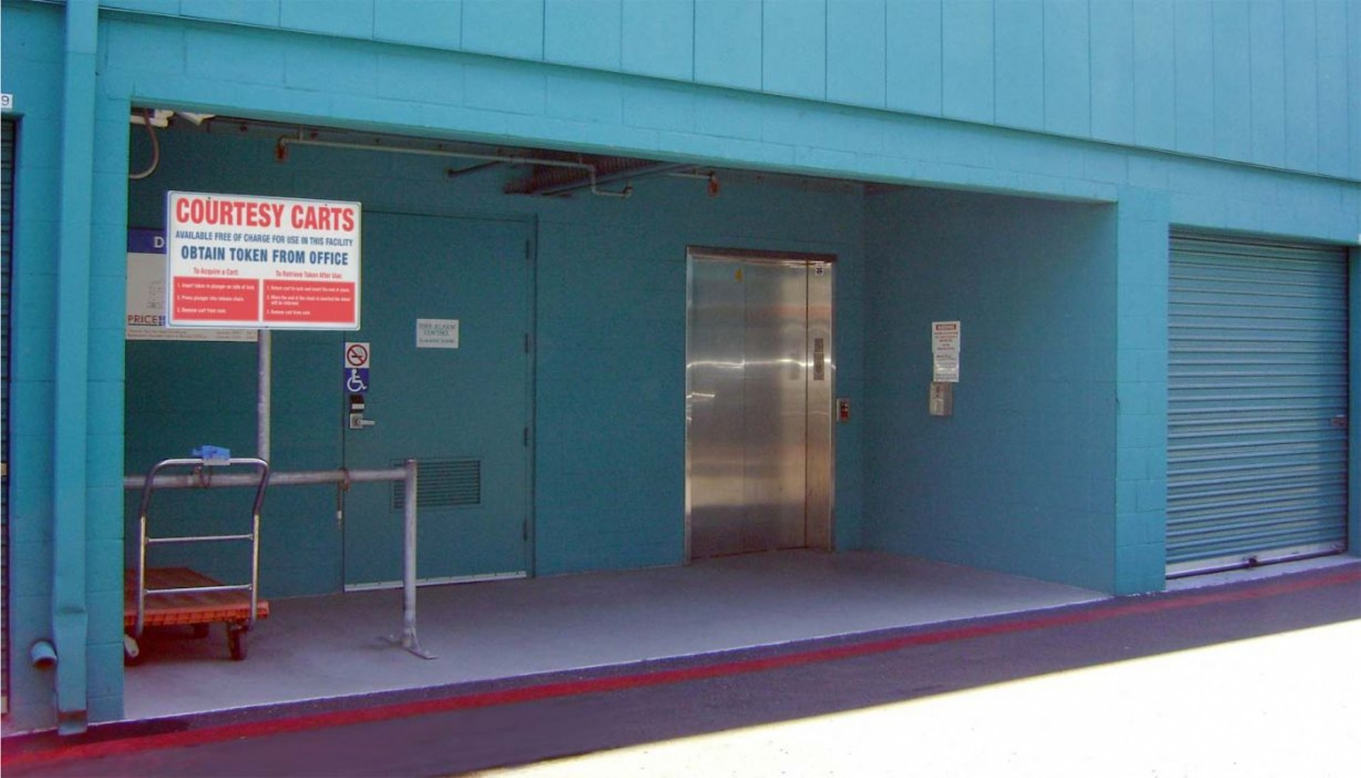 Price Self Storage Pacific Beach elevator access to building levels next to courtesy moving cart station