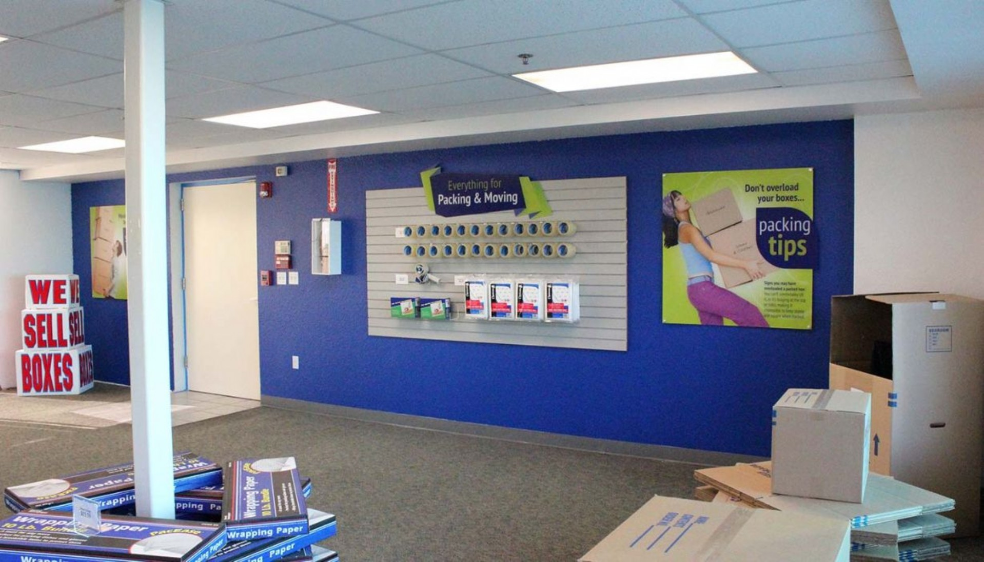Price Self Storage Pacific Beach rental office and packing and moving supplies merchandise display wall