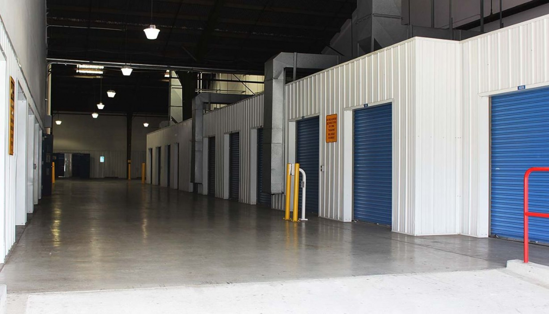 Storage facility hallway with storage lockers on both sides