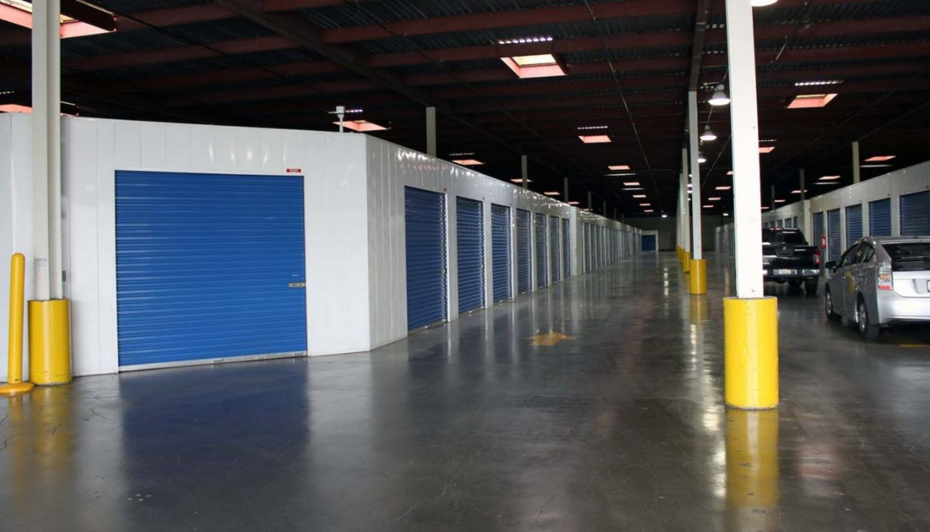 Indoor drive-in storage facility with rollup doors