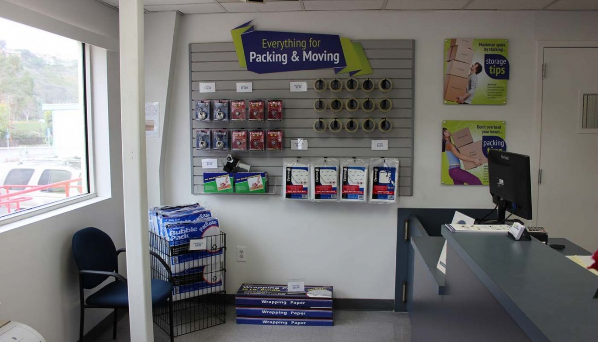 Storage rental office merchandise display wall with packing and moving supplies