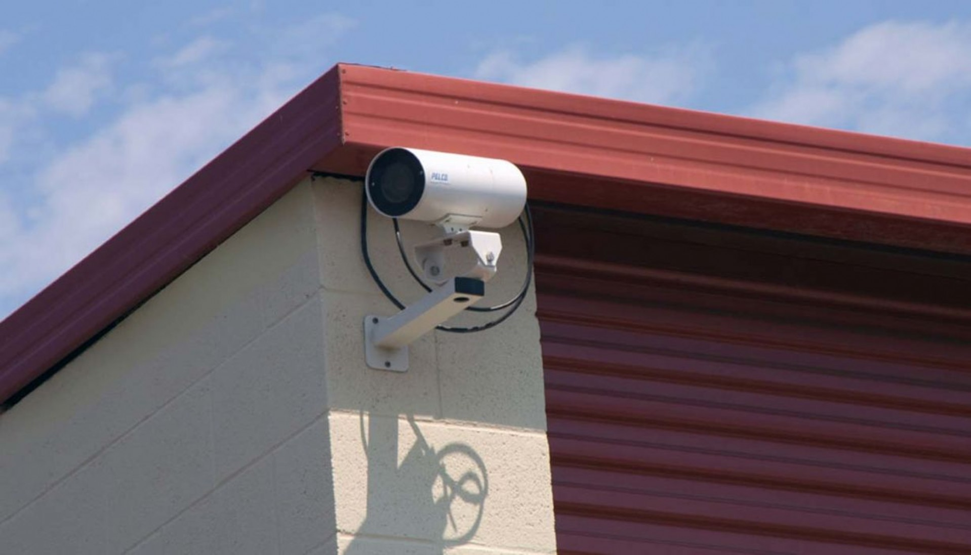 Video security camera mounted on the corner of a building