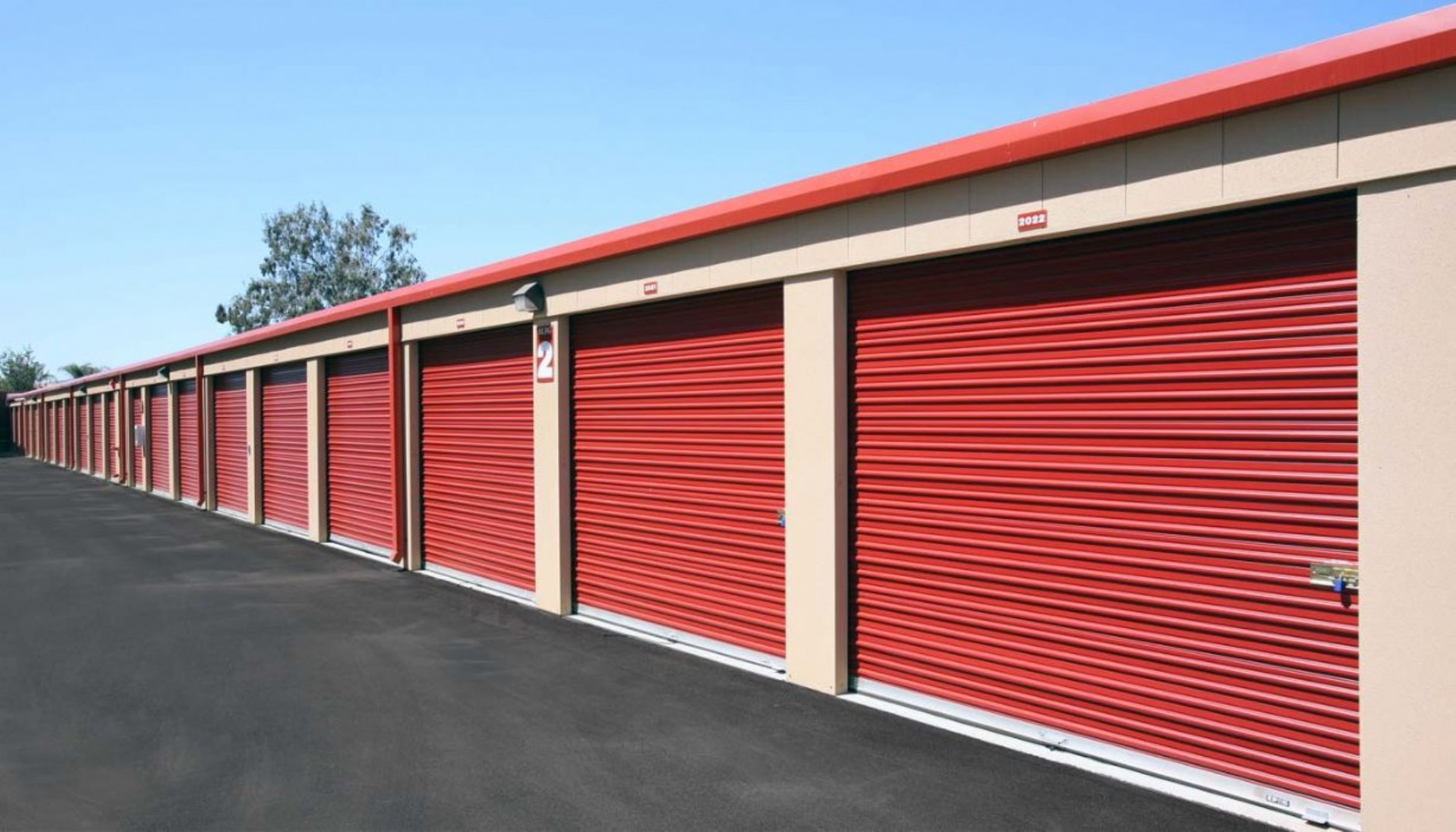 Row of garage sized storage units with rollup doors
