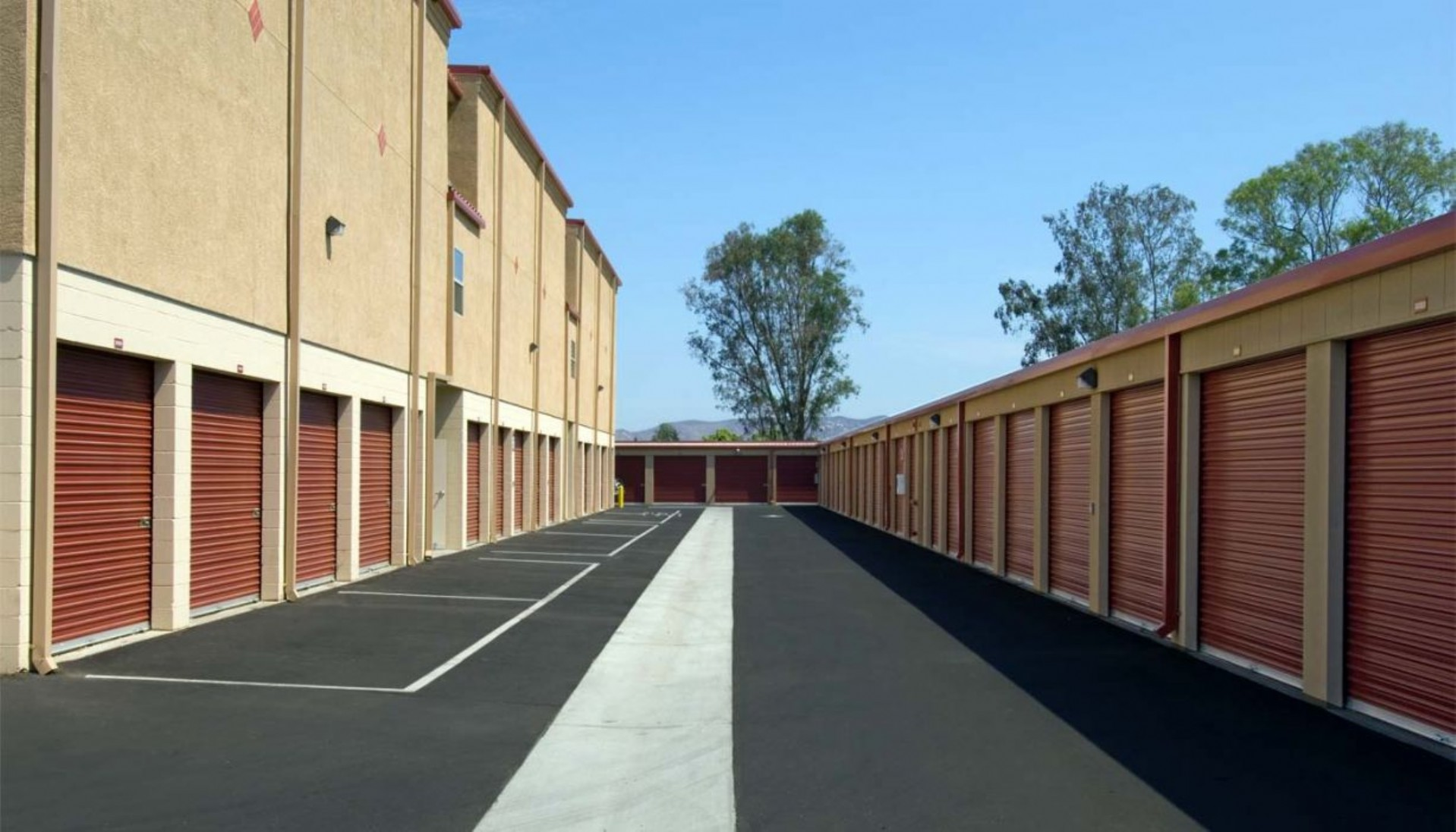 Drive aisle to ground floor large storage units with roll up doors
