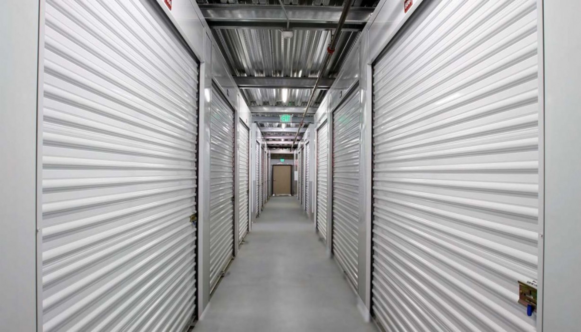 Interior hallway with various sizes of storage units with roll up doors