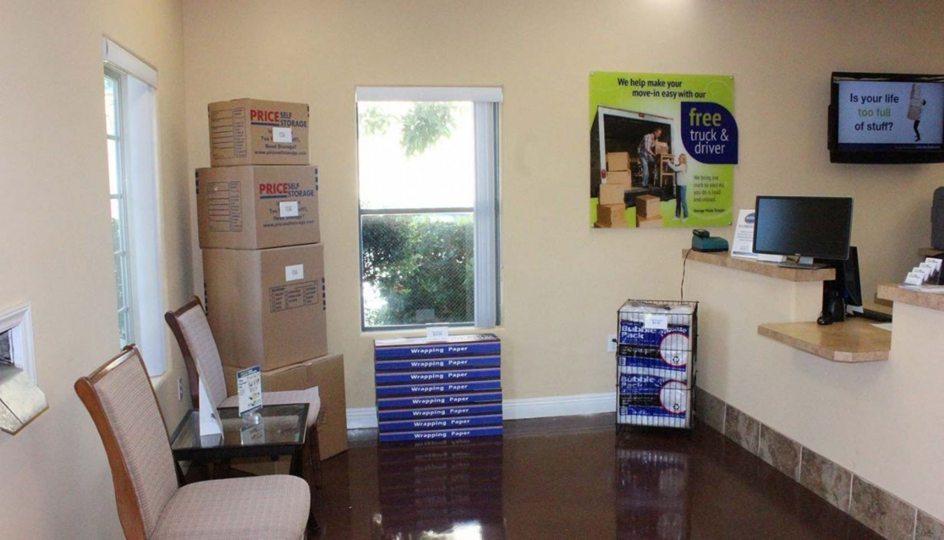 Rental office moving box display, packing paper and bubble wrap merchandise