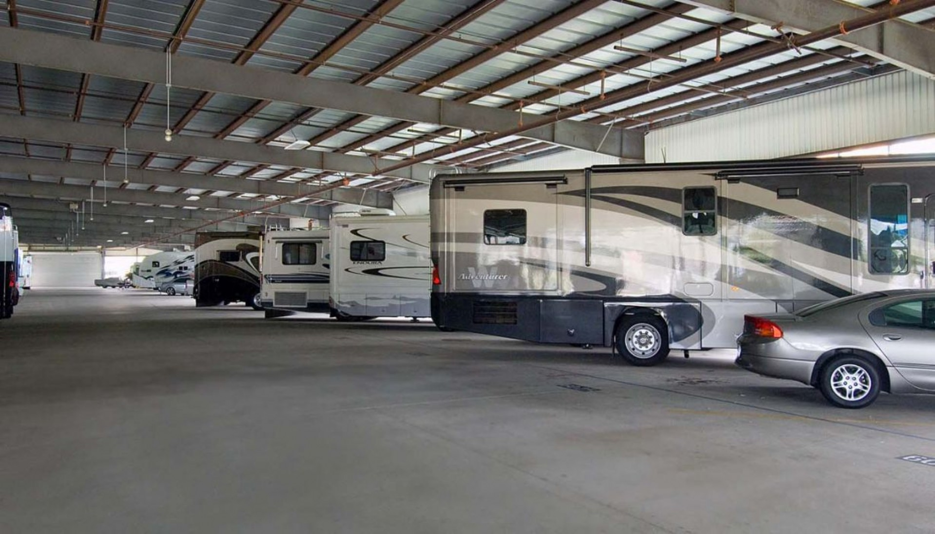 RV's, boats, cars and trailers parked inside a 100,000 sq.ft. vehicle storage facility