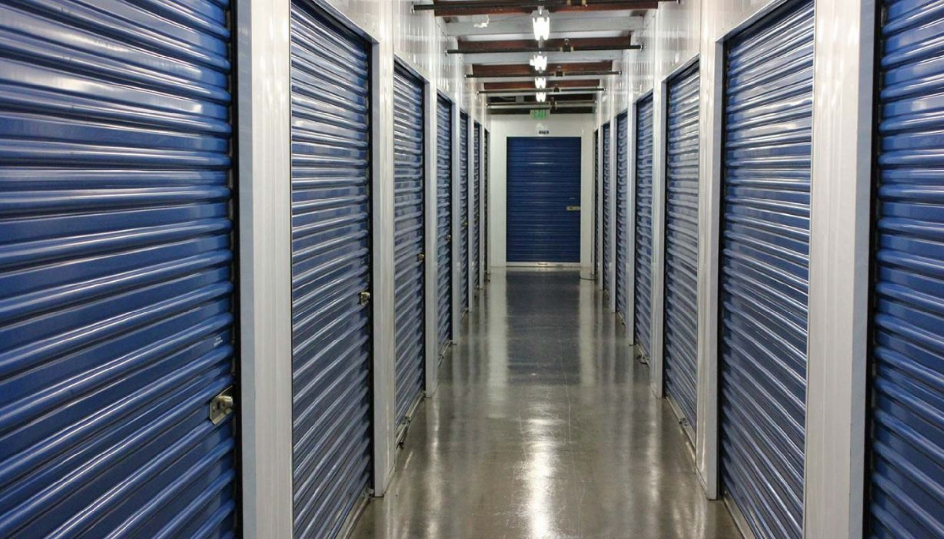 Price Self Storage Walnut Creek interior hallway with large sized storage units with roll up doors
