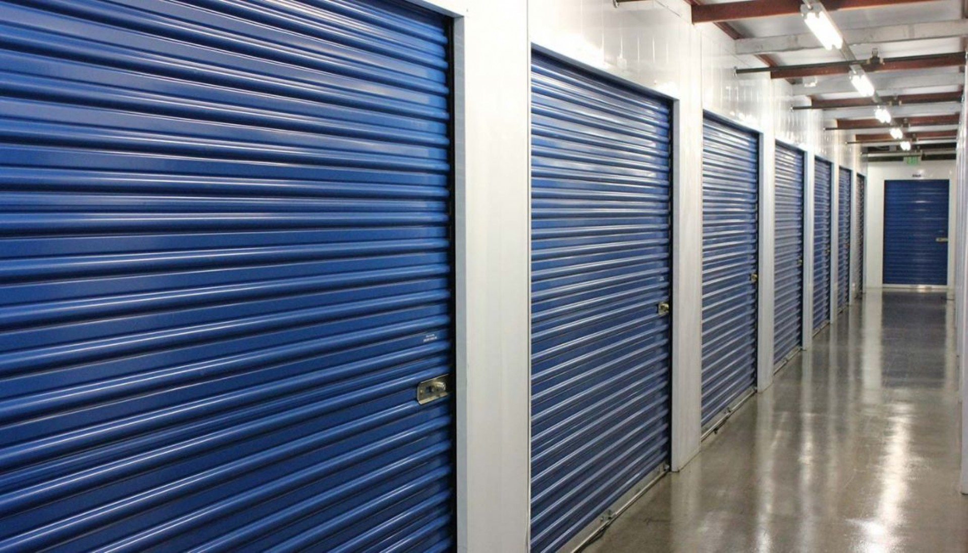 Price Self Storage Walnut Creek interior hallway with various sized storage units with roll up doors