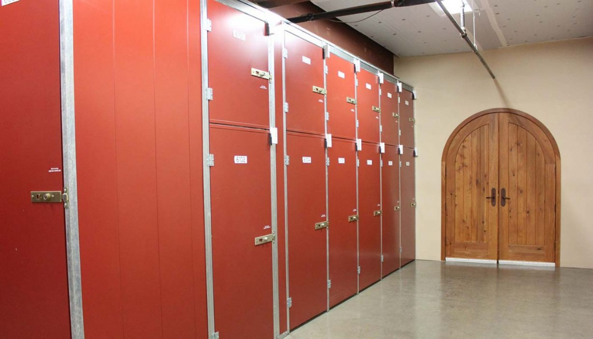 Various size wine storage lockers near wine cellar entrance door