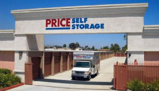 Price Self Storage Rancho Cucamonga Haven Avenue, moving truck driving through the exit gate beneath main monument sign