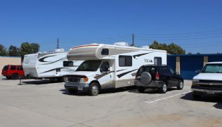 Price Self Storage Norco RV and Boat Storage - RV and SUV parked in our storage parking spaces